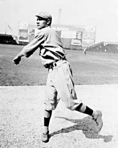 Babe Ruth pitching. He began his career as a left-handed pitcher for the Boston Red Sox in July 1914.