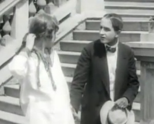 A still from Yevgeni Bauer's 1917 film Za schastem with Lev Kuleshov and Tasya Borman.
